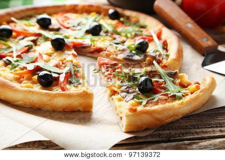 Fresh Tasty Pizza on wooden table, close up