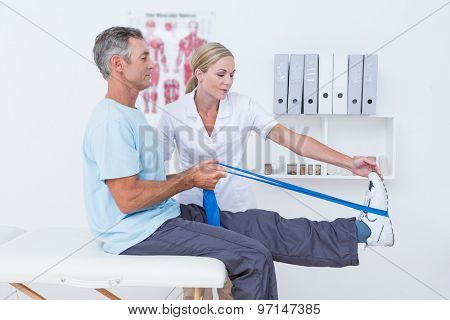 Doctor examining her patient back legs in medical office