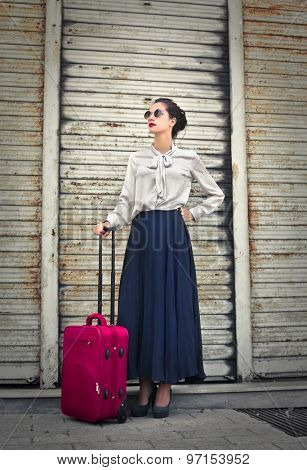 Beautiful woman with a red suitcase