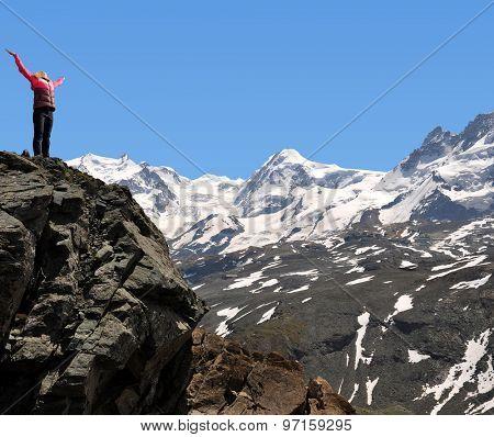 Girl on the top in Pennine Alps,Switzerland
