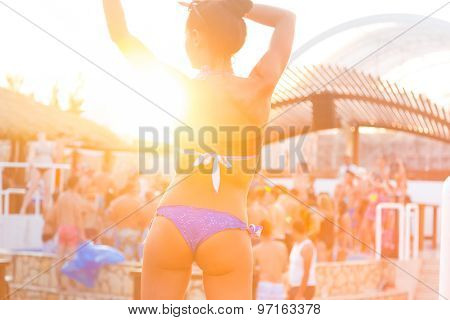 Sexy girl dancing on a beach party.