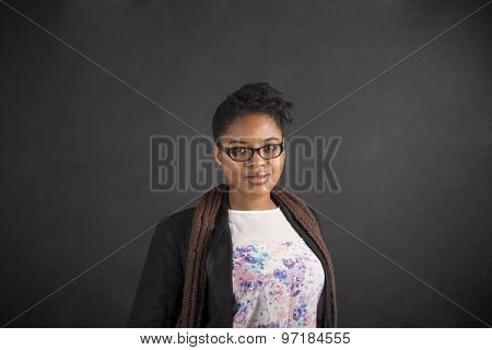 South African Or African American Woman Teacher Or Student On Chalk Black Board Background