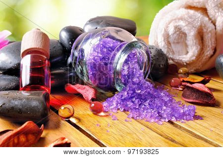 Bath Salts And Oils On Wooden In Nature