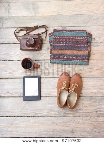 Template for photos, in Wooden floor is a sweater, shoes, camera, coffee, tablet, poster