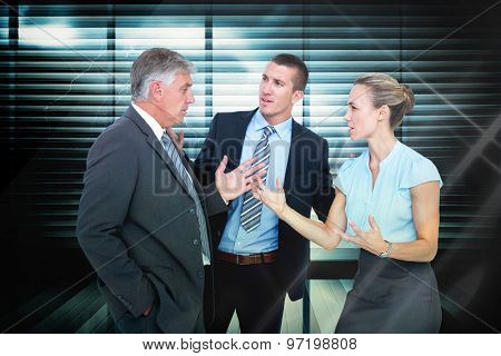 Business people having a disagreement against window overlooking city