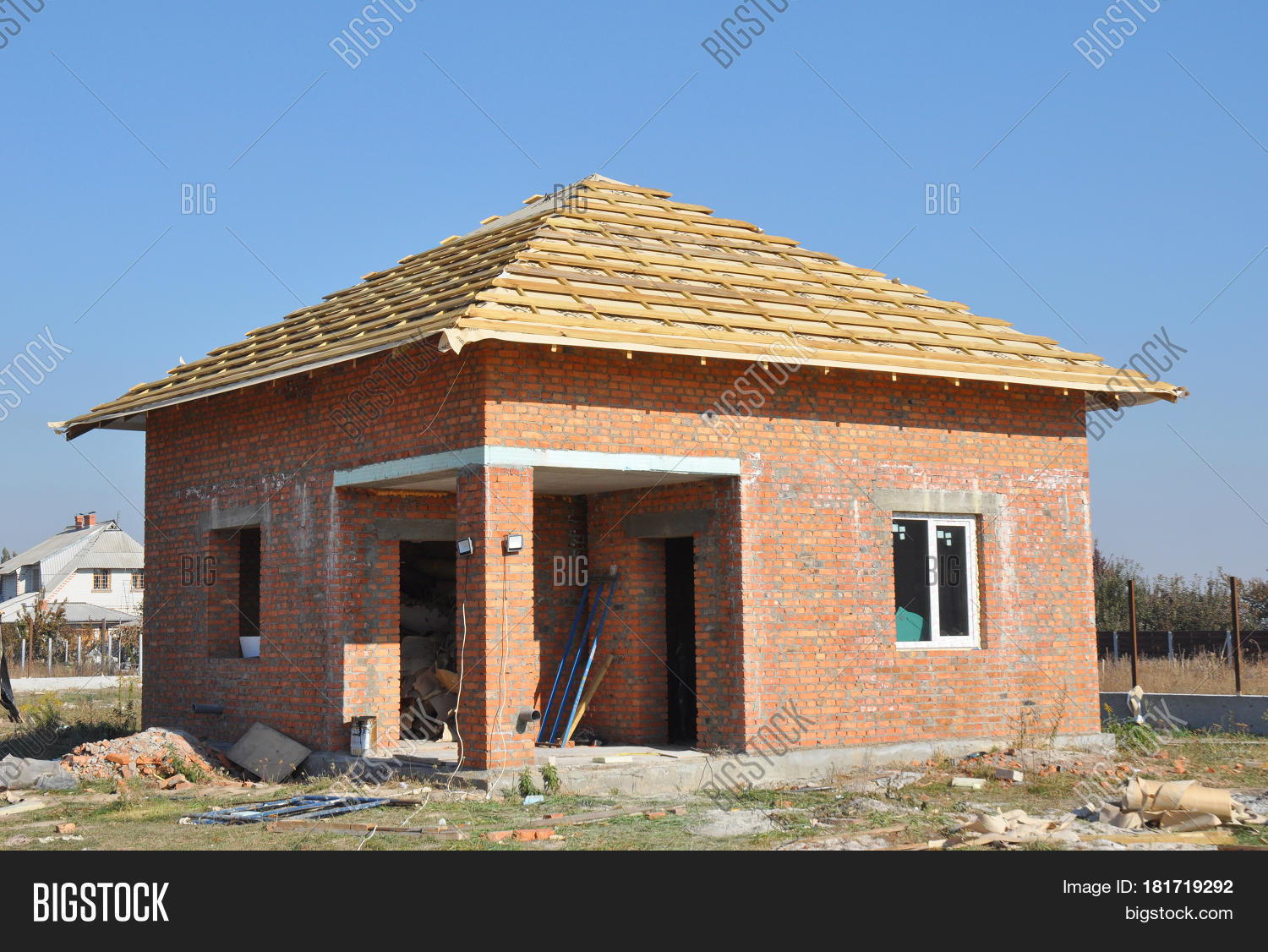 Brick House Construction Site. Roofing Construction. Roof With Wooden  Trusses And Insulation Membrane Ready