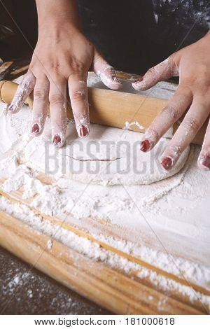 Woman Rolling Dough With Rolling Pin.