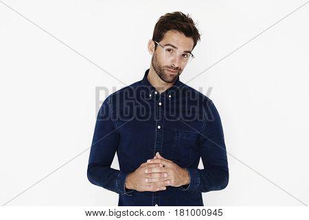 Denim dude in glasses looking at camera