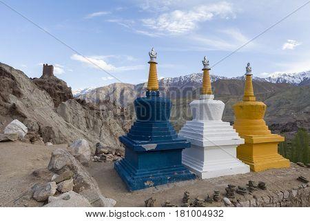 Three Colourful Tibetan Buddhist Religious Stupas Near A Buddhist Monastery, Leh Ladakh, India.