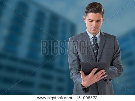 Digital composite of Businessman on tablet against blue background