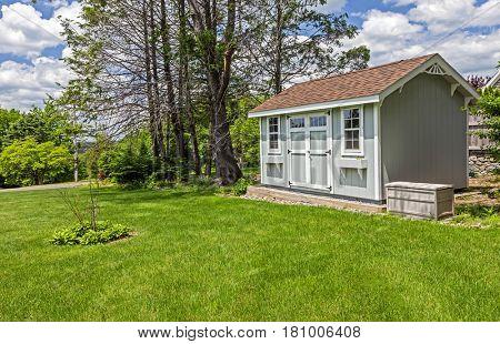 New blue garden shed in beautiful garden poster