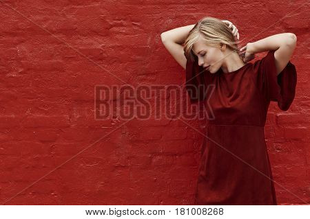 Red dress beauty against red wall color