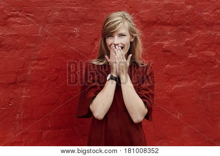 Laughing lady in red dress portrait color