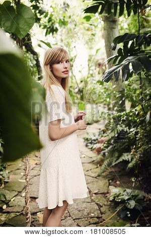 Blond and beautiful woman in garden portrait