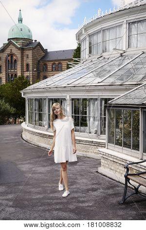 Beautiful woman wearing white dress in park portrait