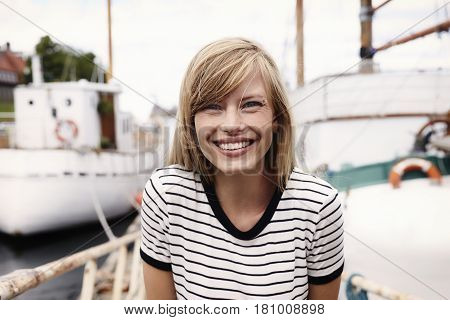 Stunning smiling sailor blond woman portrait outdoor