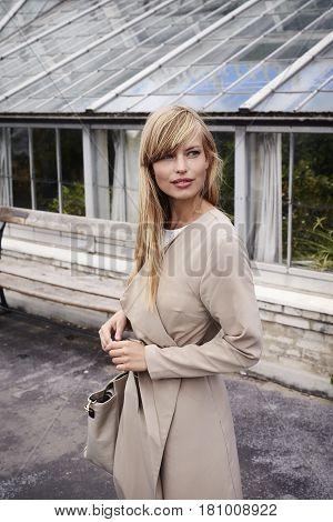 Stunning blond n coat looking away outdoor