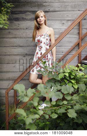 Portrait of beautiful woman in floral dress
