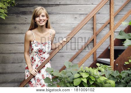 Portrait of woman in summer dress smiling