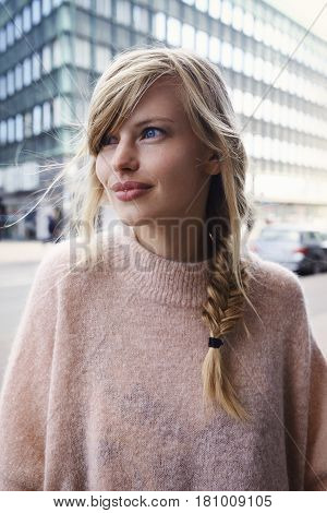 Cute Blue eyed city girl looking away
