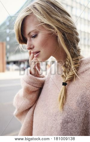 Beautiful woman with blond plated hair in the city