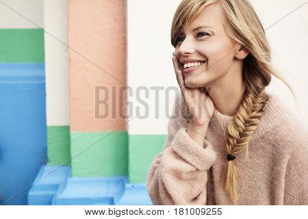 Smiling beautiful woman looking away nude colors