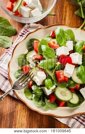 Fresh Spinach Salad With Feta, Cucumber And Red Paprika On A Pla