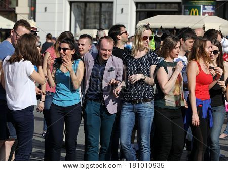 CRACOW POLAND - APRIL 1 2017: International Flashmob Day of Rueda de Casino 57 countries 160 cities. Several hundred persons dance Hispanic rhythms on the Main Square in Cracow. Poland