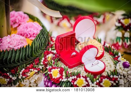 Dowry (gold necklace) on flower tray in Thai traditional wedding