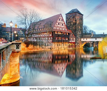 Nuremberg Germany with a bridge at night.