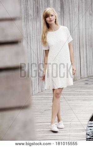 Beautiful women in white dress looking at camera
