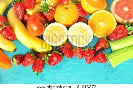 Fruits fresh mix of strawberries lemon and seasonal products from the market to the table top view image - Concept of healthy vegetarian food and vitamins source