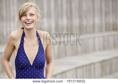 Blonde Swimsuit beauty laughing at camera portrait