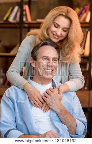 Beautiful Smiling Blonde Woman Hugging Happy Mature Man