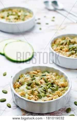 cheese pepita oats zucchini casserole on stone background