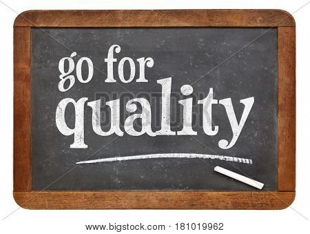go for quality sign - white chalk text on a vintage slate blackboard