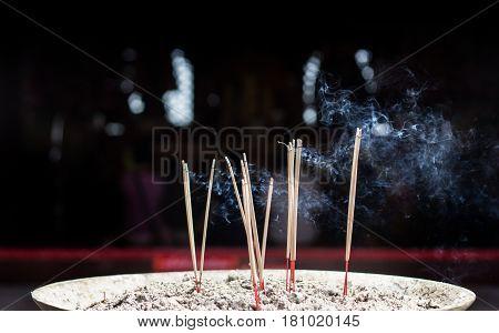 Burning Incense On Sand Box