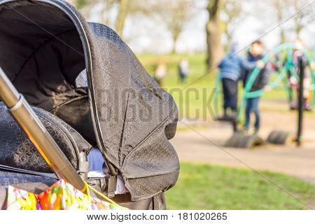 Baby buggy close up view in sunny playground.