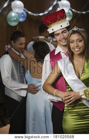 Multi-ethnic prom king and queen dancing