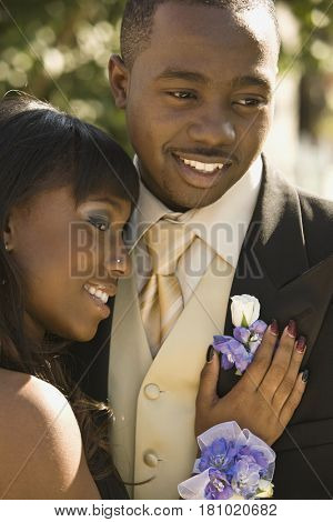 African teenaged couple hugging