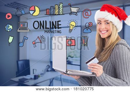 Digital composite of Woman wearing Santa hat while shopping online