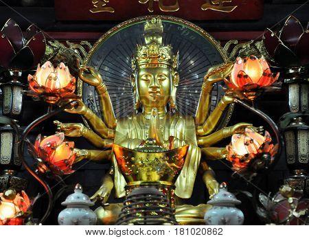 Small Shrine Devoted To Avalokitesvara Boddhisatva. One Pillar Pagoda, Hanoi, Vietnam