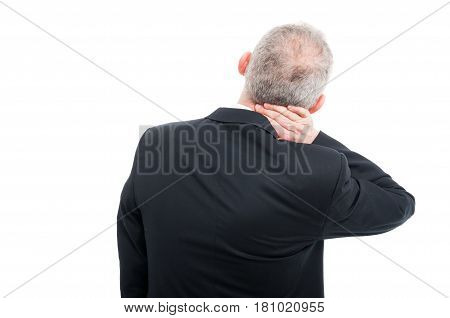 Back View Of Senior Holding His Neck Like Hurting