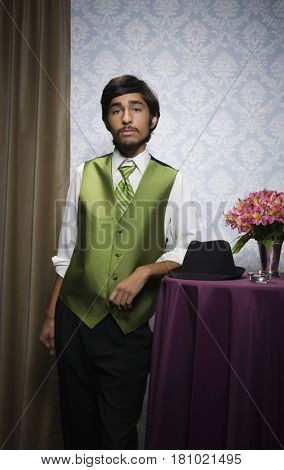 Pacific Islander teenaged boy wearing suit