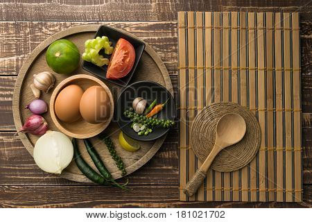 egg and spice for cook healthy on table wood background in top veiw.