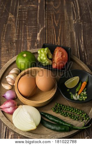 eggs and spice for cook healthy on table wood background