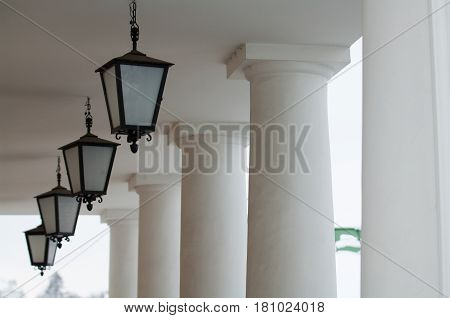 Vintage lanterns and columns in the open air