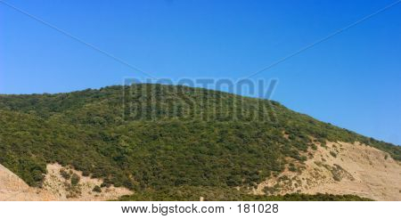Hills With Blue Sky On Background