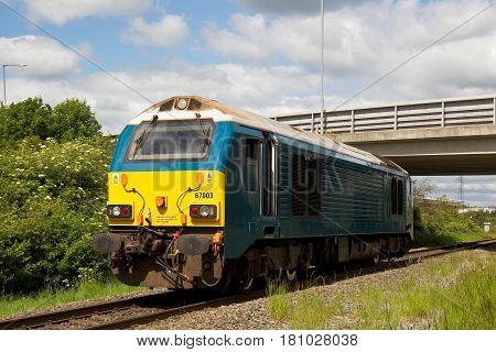 AYLESBURY, UK - JUNE 3: A class 67 diesel locomotive heads north toward the Calvert landfill plant to pick up a rake of empty trucks for return to Willesden depot on June 3, 2015 in Aylesbury