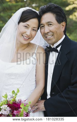 Asian newlyweds hugging